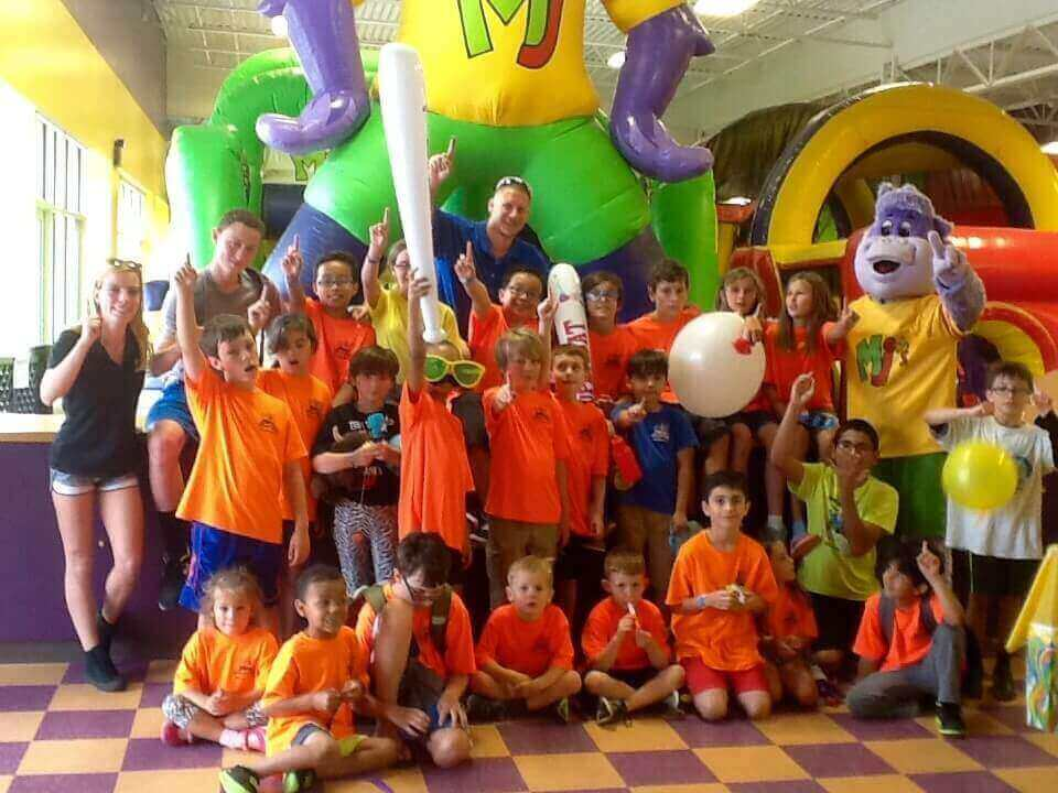 kids enjoying indoor summer camp activity in Virginia