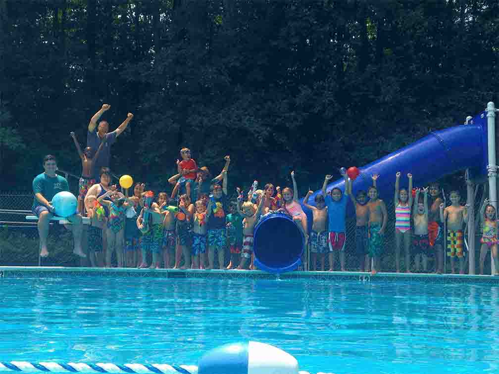 kids posting for picture during their weekend swimming activity at WKFairfax summer camp for kids in Virginia