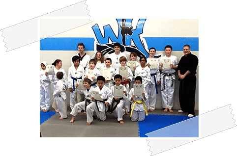 World Karate summer camp enrollees showing their karate certificates